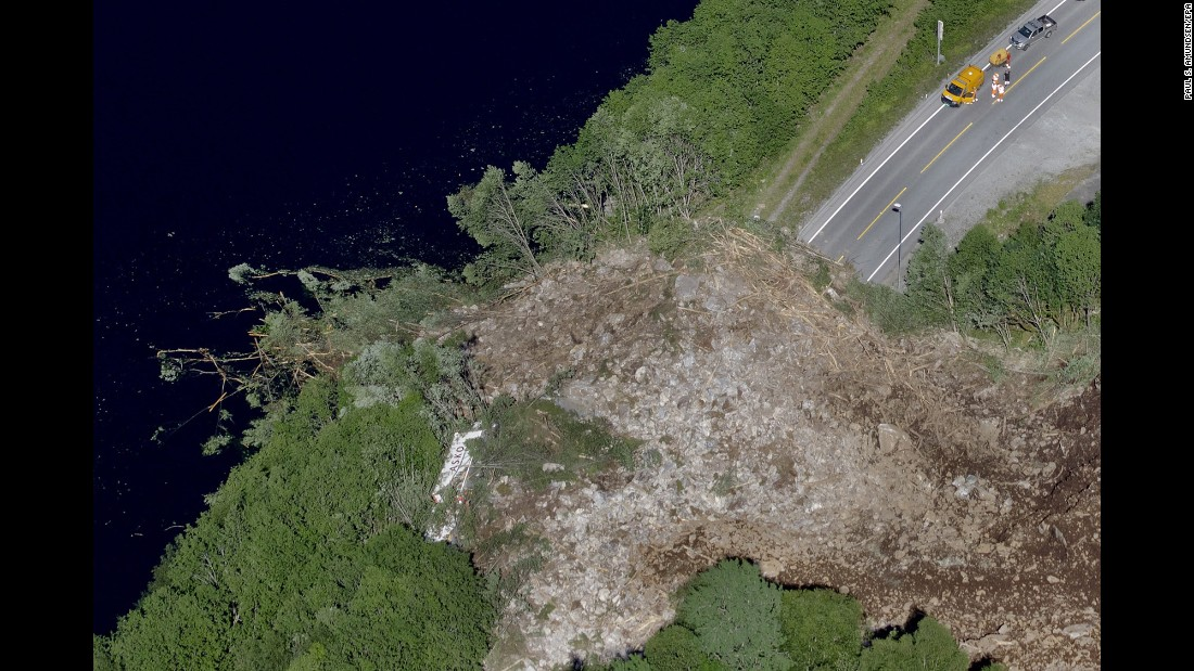 This aerial photo shows a large landslide covering a road in Voss, Norway, on Wednesday, June 8. The truck on the left was hit but the driver was not injured.