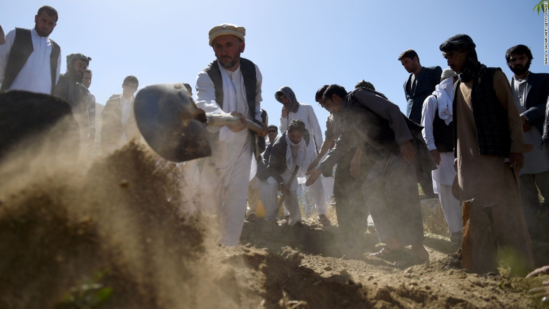 "Friends and relatives of Afghan reporter Zabihullah Tamanna cover his grave with soil during his burial ceremony in Kabul, Afghanistan, on Tuesday, June 7. Tamanna, 38, was traveling in southern Afghanistan when <a href=""http://money.cnn.com/2016/06/05/media/npr-photographer-david-gilkey-interpreter-killed-afghanistan/"" target=""_blank"">he and NPR's David Gilkey were killed</a> on Sunday, June 5. Gilkey, <a href=""http://www.cnn.com/2016/06/06/middleeast/gallery/david-gilkey-npr-photographer/index.html"" target=""_blank"">an award-winning photographer</a> and video editor, was 50."