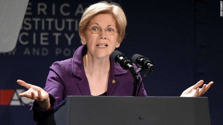 Sen. Elizabeth Warren, D-Mass., gestures at the American Constitution Society for Law and Policy 2016 National Convention, Thursday, June 9, 2016, in Washington.