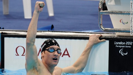 LONDON, ENGLAND - SEPTEMBER 07:  Bradley Snyder of the United States celebrates after winning gold in the Men's 400m Freestyle - S11 final on day 9 of the London 2012 Paralympic Games at Aquatics Centre on September 7, 2012 in London, England.  (Photo by Shaun Botterill/Getty Images)