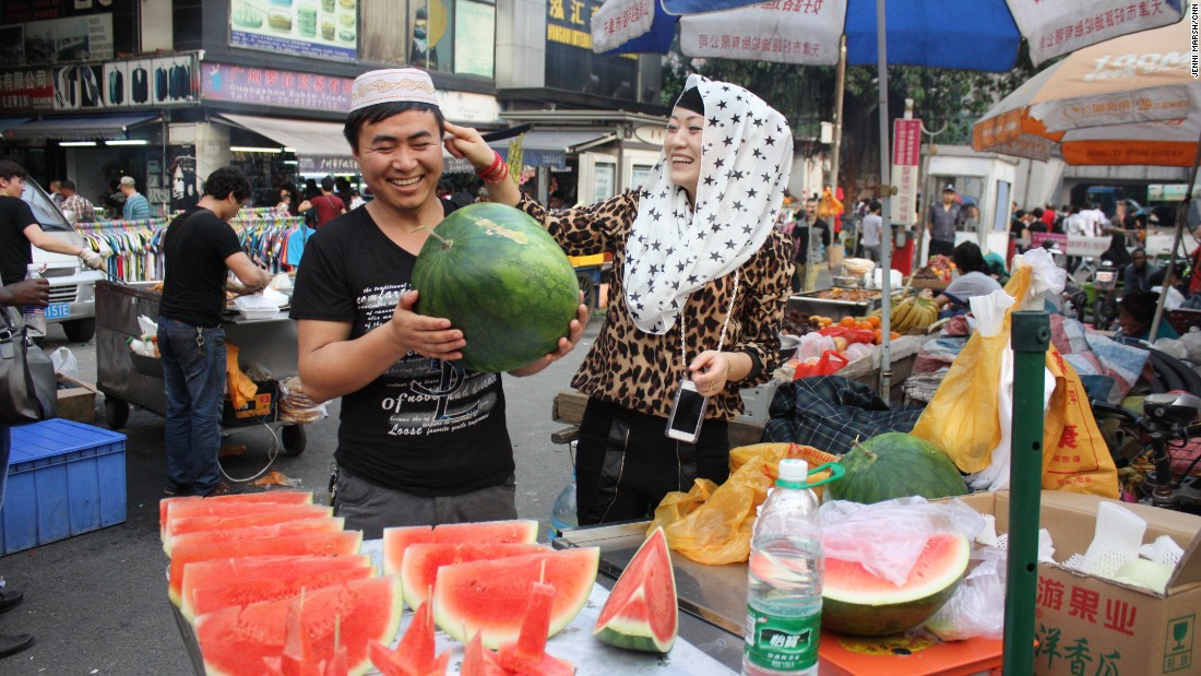A couple from Xinjiang in north-west China sell fresh fruit in Little Africa. The Dengfeng urban village was home to migrants from across China, as well as Africa.