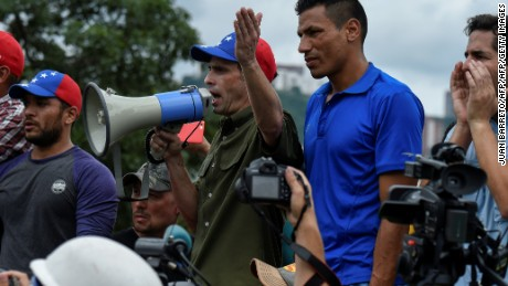Miranda state Governor Henrique Capriles argues with police in an opposition march blocked from reaching the National Electoral Court in Caracas to demand validation of the signatures to initiate a recall referendum against President Nicolas Maduro, on June 7, 2016. / AFP / JUAN BARRETO        (Photo credit should read JUAN BARRETO/AFP/Getty Images)