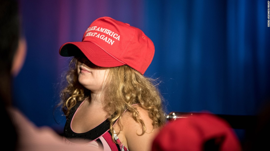 "A girl wears a ""Make America Great Again"" hat at a Donald Trump rally in Westchester, New York, on Tuesday, June 7."
