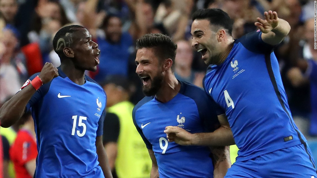 From left, French players Paul Pogba, Olivier Giroud and Adil Rami celebrate Giroud's opening goal in the 57th minute.