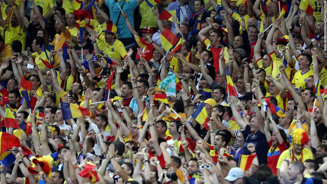 Romania's fans rejoice in the stands after Stancu's penalty.