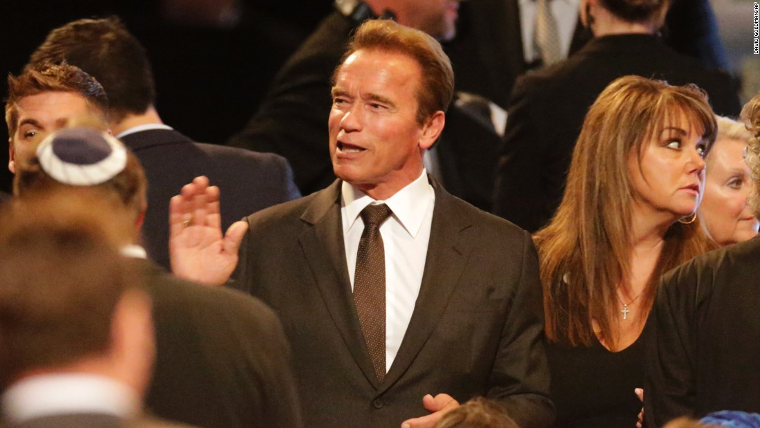 Actor Arnold Schwarzenegger arrives at the service.
