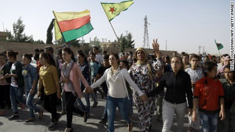 Syrian Kurds march at the funeral of fighters who died in an assault in Manbij, on June 4, 2016.