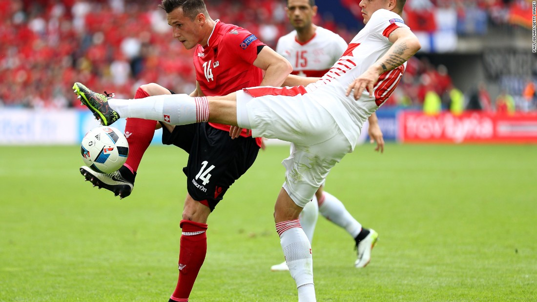 Brothers Taulant Xhaka of Albania and Granit Xhaka of Switzerland compete for the ball.