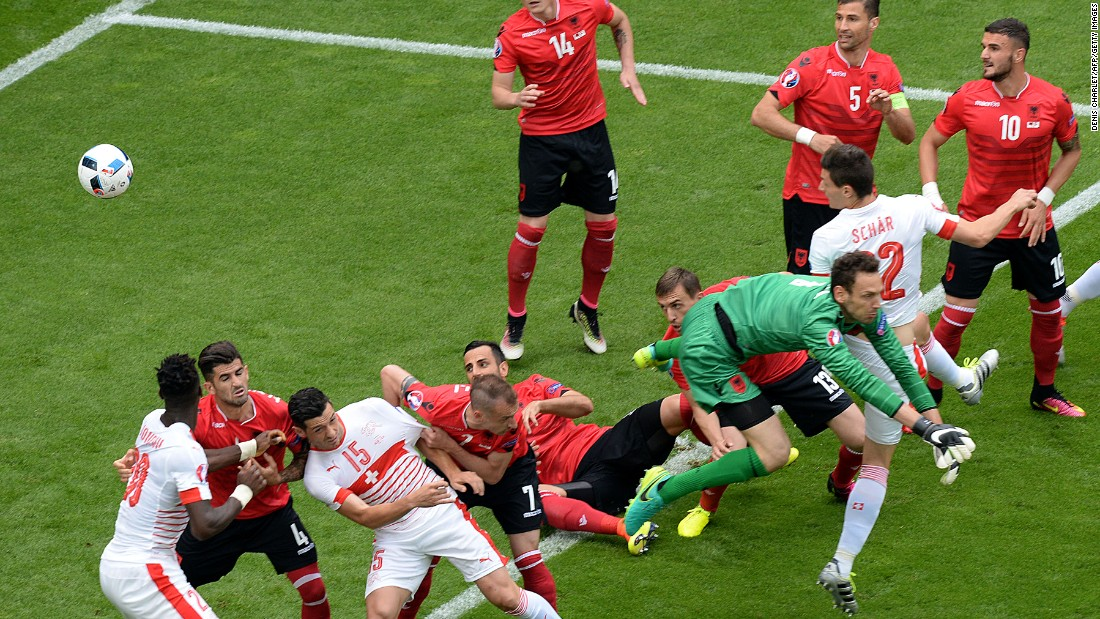 Switzerland's defender Fabian Schaer, second right,  heads the ball to score.