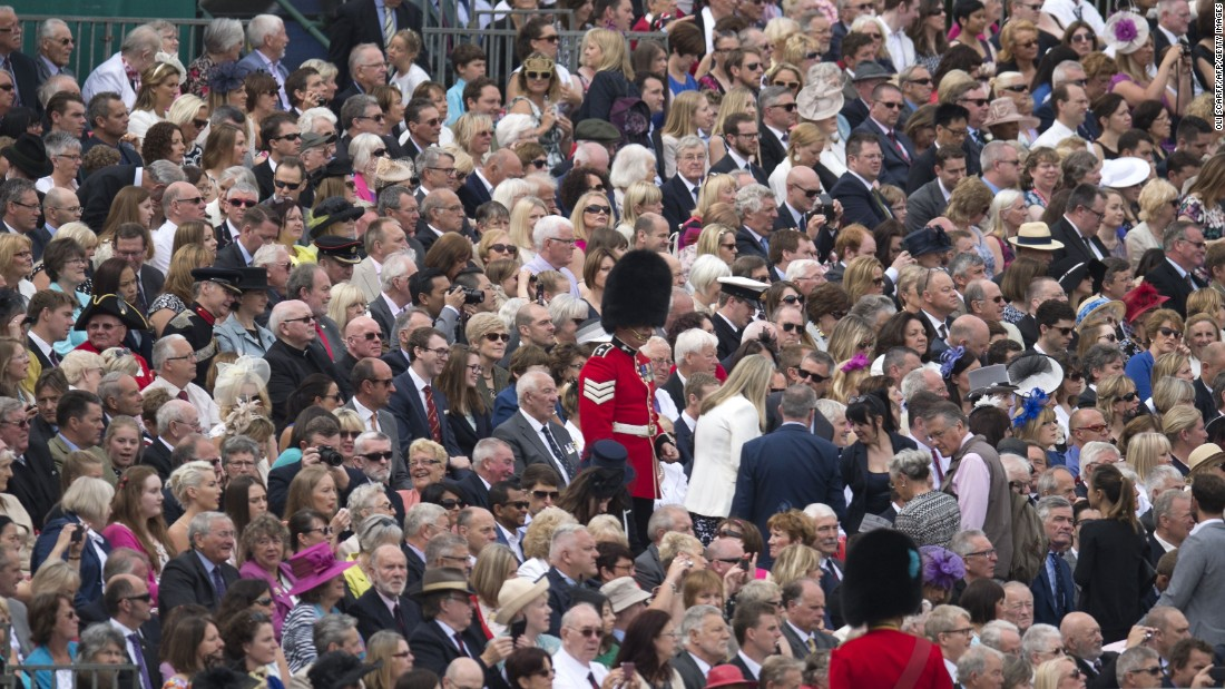 "Soldiers direct guests to their seats to watch the traditional <a href=""http://edition.cnn.com/2016/06/11/europe/queen-elizabeth-birthday-britain/index.html"">Trooping the Color</a> in London on Saturday, June 11. The Queen continues to celebrate her 90th birthday with the display of more than 1,400 officers and men in their famous red jackets and black bearskin hats, with 200 horses and more than 400 musicians."