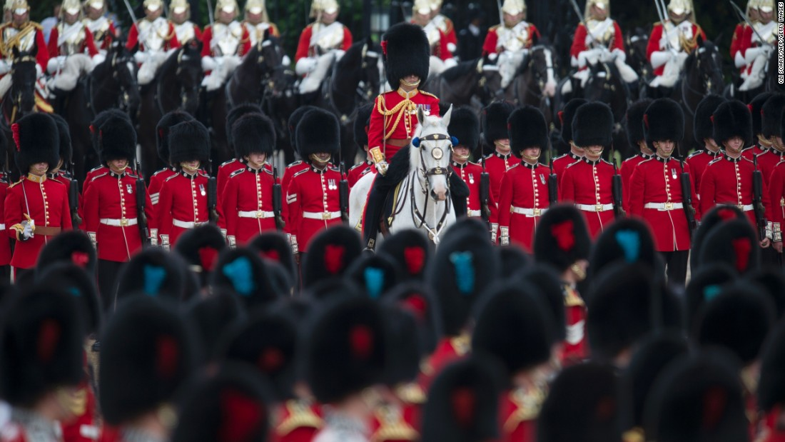 Members of The Foot Guards and The Household Cavalry march. The monarch is technically the head of Britain's armed forces, and would traditionally lead an army into war. The parade gives the Queen a chance to review and approve her army.