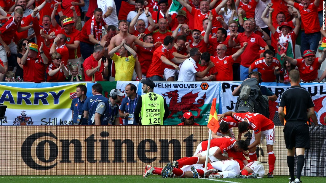 Wales players celebrate their team's second goal scored by Hal Robson-Kanu.  It has been 58 years since Wales last played in a major tournament.