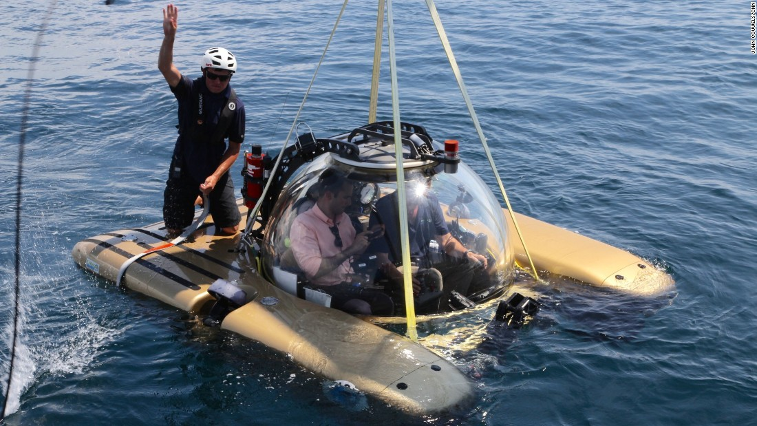 Diver Robert Carmichael preparing to dive to the Hollywood Beach sewage outflow, just one mile from shore, with CNN correspondent Boris Sanchez.