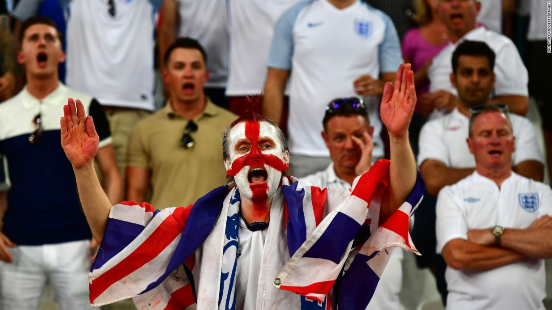 An England supporter cheers on his team.