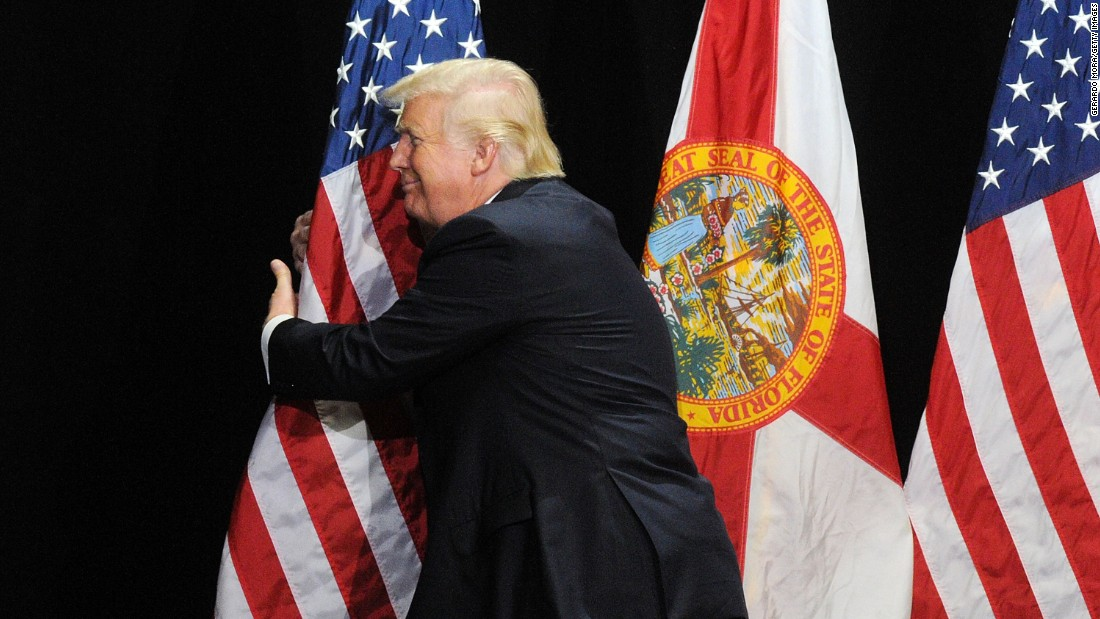 "Donald Trump, the Republican Party's presumptive nominee, hugs the U.S. flag <a href=""http://www.cnn.com/2016/06/11/politics/donald-trump-republicans-unity/index.html"" target=""_blank"">during a campaign rally </a>in Tampa, Florida, on Saturday, June 11."