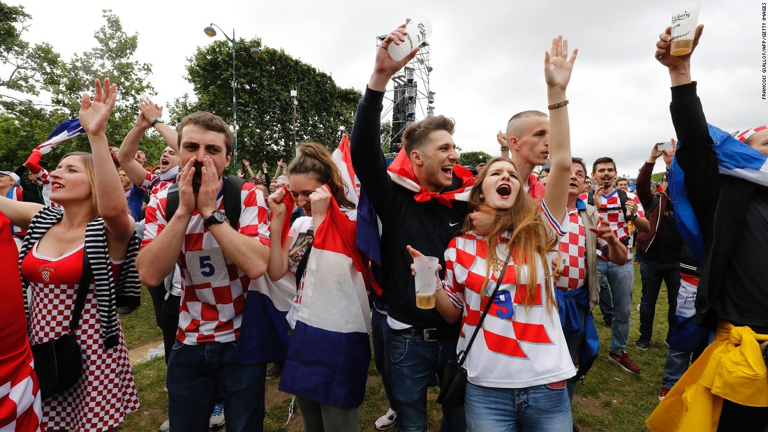 Croatian supporters in a Paris fan zone celebrate their team's victory.