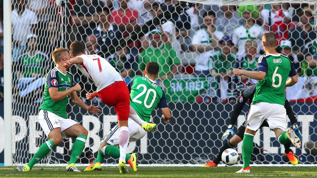 Poland's Arkadiusz Milik, second from left, scores a goal against Northern Ireland during their Euro 2016 opener in Nice, France. Poland won 1-0.