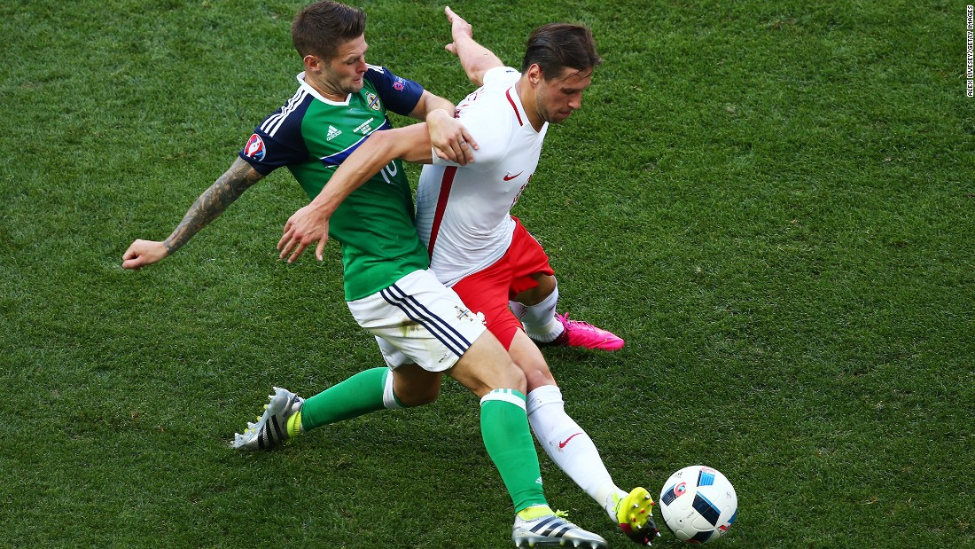 Poland's Grzegorz Krychowiak, right, competes for the ball with Northern Ireland's Oliver Norwood.