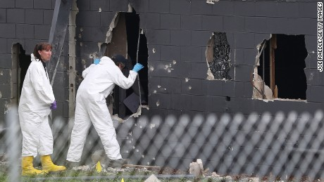 ORLANDO, FL - JUNE 12:  FBI agents investigate near the damaged rear wall of the Pulse Nightclub where Omar Mateen allegedly killed at least 50 people on June 12, 2016 in Orlando, Florida. The mass shooting killed at least 50 people and injuring 53 others in what is the deadliest mass shooting in the country's history.  (Photo by Joe Raedle/Getty Images)