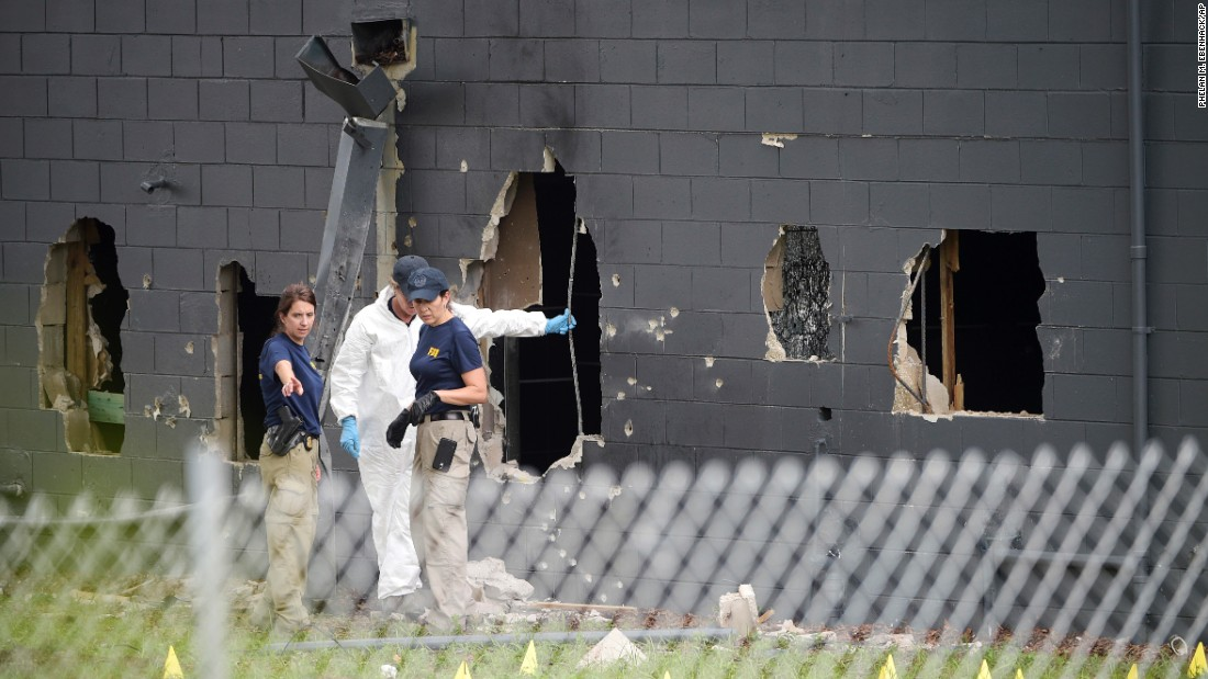 Police investigate the back of the Pulse nightclub in Orlando on Sunday, June 12. At least 49 people were killed there by Omar Mateen, who was shot and killed by Orlando police. It was the deadliest mass shooting in U.S. history.