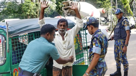 A man is frisked by Bangladesh police on June 10, 2016.