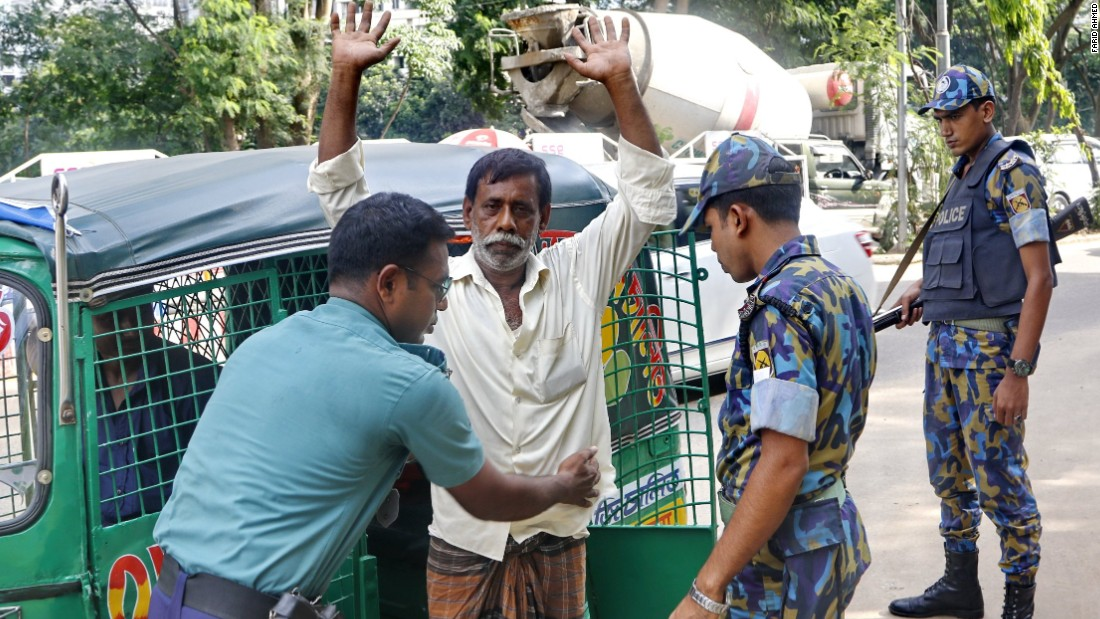 A man is frisked at a police check-post in Gulshan, Dhaka on June 10.