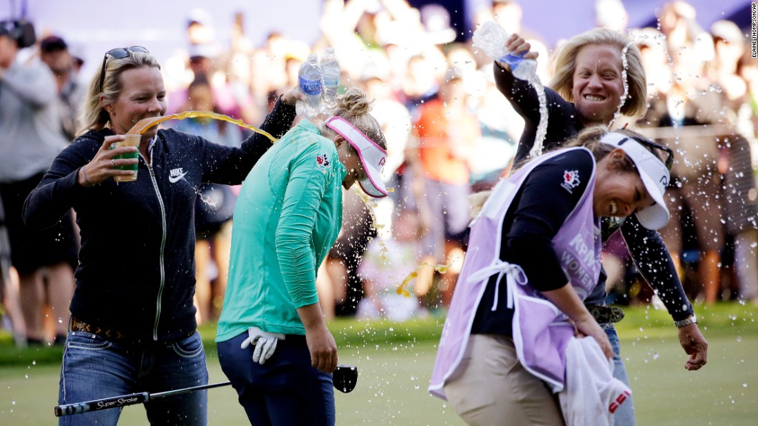 "Pro golfer Brooke Henderson, second from left, is doused after <a href=""http://www.cnn.com/2016/06/13/golf/golf-lydia-ko-brooke-henderson/"" target=""_blank"">winning the Women's PGA Championship</a> on Sunday, June 12. In front of her is her caddie and sister, Brittany. Henderson, 18, defeated world No. 1 Lydia Ko in a playoff."