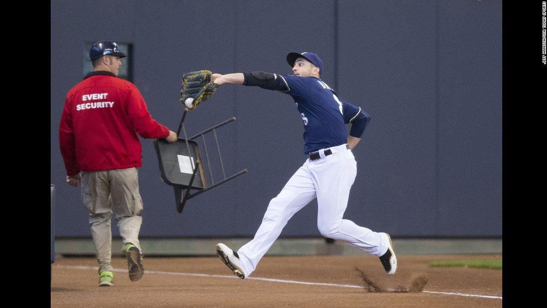 Milwaukee's Ryan Braun makes a running catch in foul territory during a home game on Wednesday, June 8.