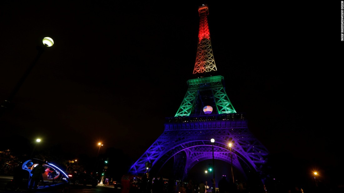 The Eiffel Tower in Paris is illuminated in rainbow colors on June 13.