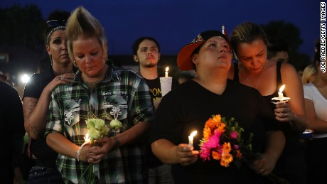ORLANDO, FL - JUNE 13: Crystal Murphy, Krya Murphy, Nicole Edwards and Kellie Edwards (L-R) stand together during a memorial service at the Dr. Phillips Center for the Performing Arts for the victims of the Pulse gay nightclub shooting where Omar Mateen allegedly killed 49 people, June 13, 2016 in Orlando, Florida. At least 49 people were killed and 53 others injured in what is the deadliest mass shooting in the country's history.  (Photo by Joe Raedle/Getty Images)