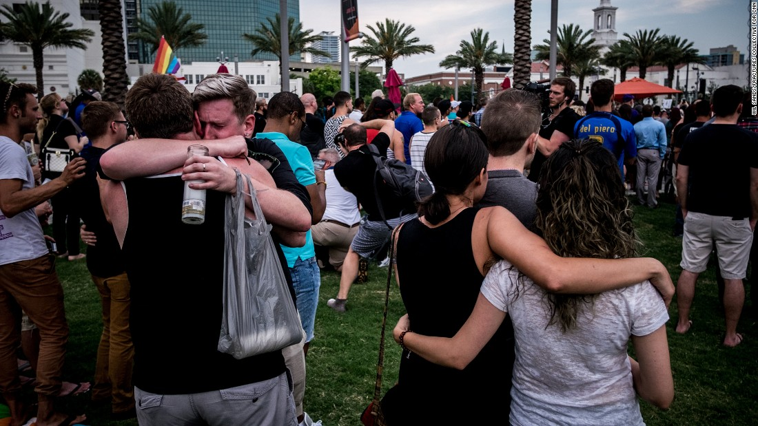 Mourners embrace at the vigil, which took place in front of the Dr. Phillips Center for the Performing Arts in downtown Orlando.