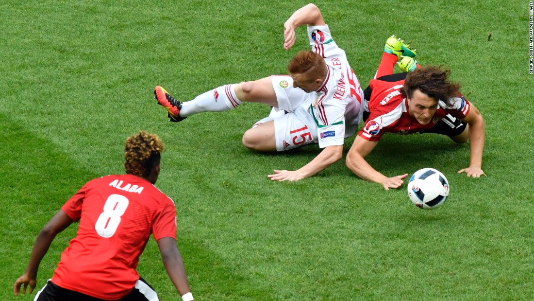 Austrian midfielder Julian Baumgartlinger, right, clashes with Hungarian midfielder Laszlo Kleinheisler.