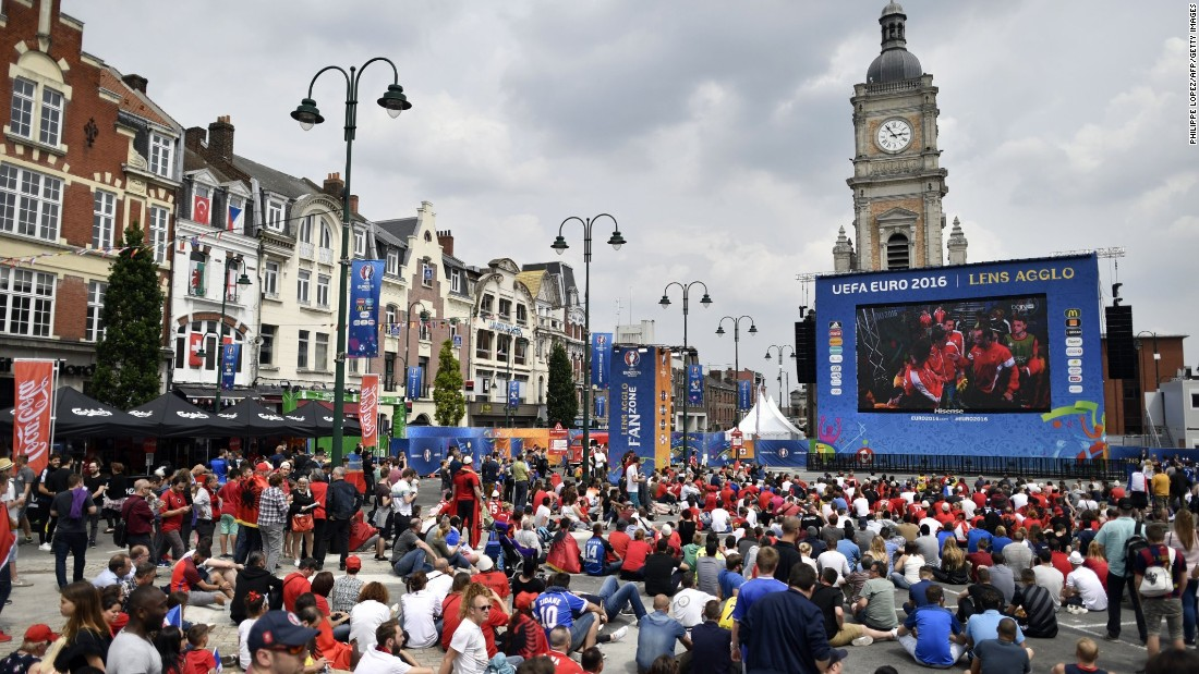 Fans watch a Euro 2016 match on a giant screen in Lens, France, on Saturday, June 11. The small city -- population 34,190 -- is expecting 50,000 fans for the England-Wales match on Thursday, and authorities are bolstering security in light of the influx and recent fan violence in Marseille.