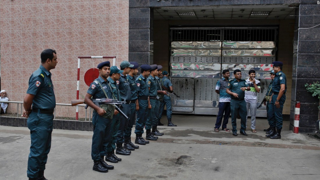 Bangladeshi policemen stand guard outside the Dhaka Central Jail.