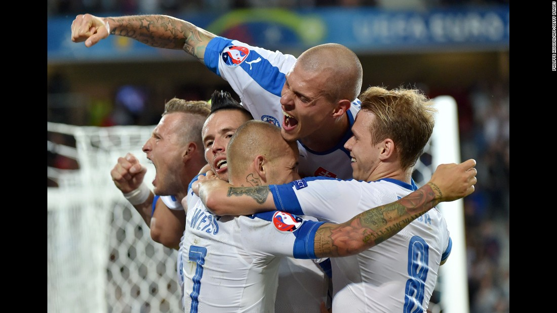Slovakian players celebrate Hamsik's goal, which gave them a 2-0 lead just before halftime.