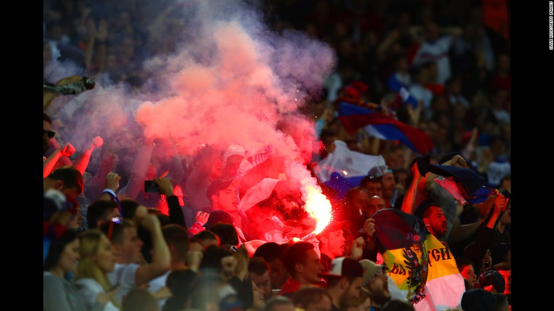 A flare is seen in the crowd where Russia supporters were sitting.