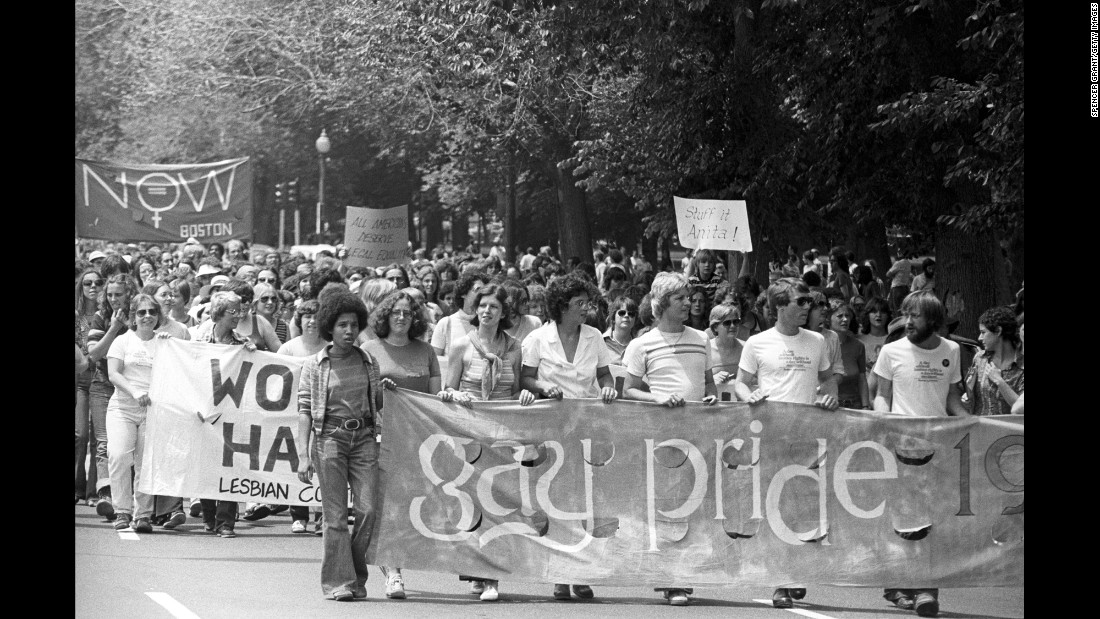 A crowd holds banners as they march in the Back Bay neighborhood of Boston in 1970.