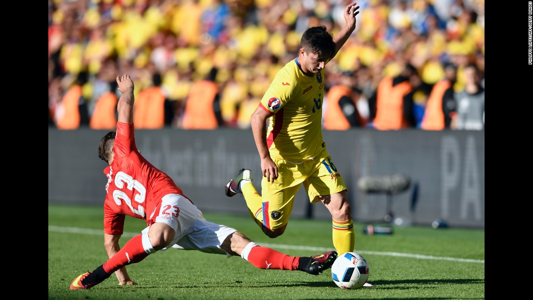 Romanian defender Steliano Filip is challenged by Switzerland's Xherdan Shaqiri.