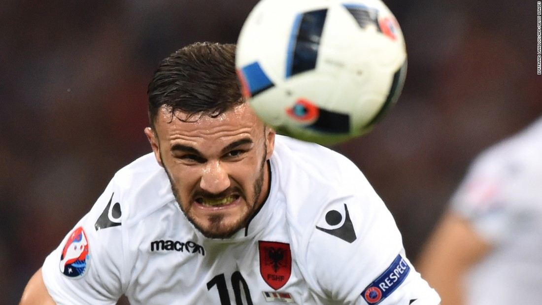 Albania's Armando Sadiku heads the ball.