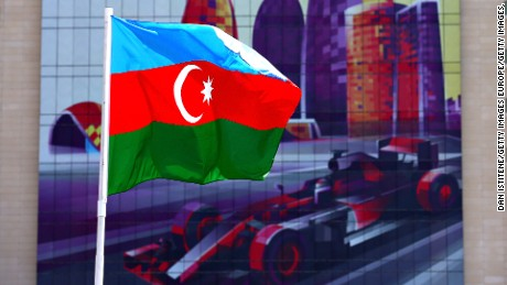BAKU, AZERBAIJAN - JUNE 16: The Azerbaijan flag flies in front of a building with an F1 car graphic on during previews ahead of the European Formula One Grand Prix at Baku City Circuit on June 16, 2016 in Baku, Azerbaijan.  (Photo by Dan Istitene/Getty Images,)