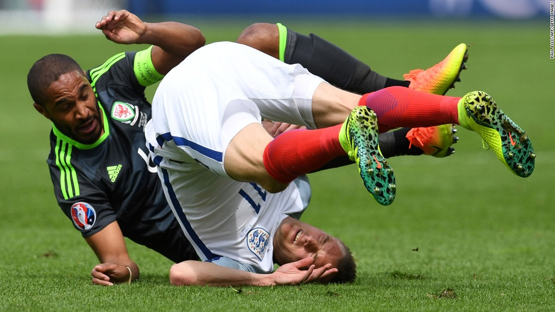 Vardy falls over after colliding with Welsh defender Ashley Williams.