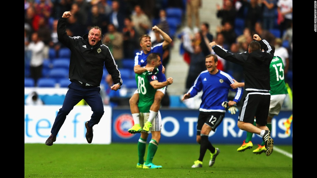 Northern Ireland manager Michael O'Neill, left, celebrates a late goal during a 2-0 victory over Ukraine in Lyon, France.