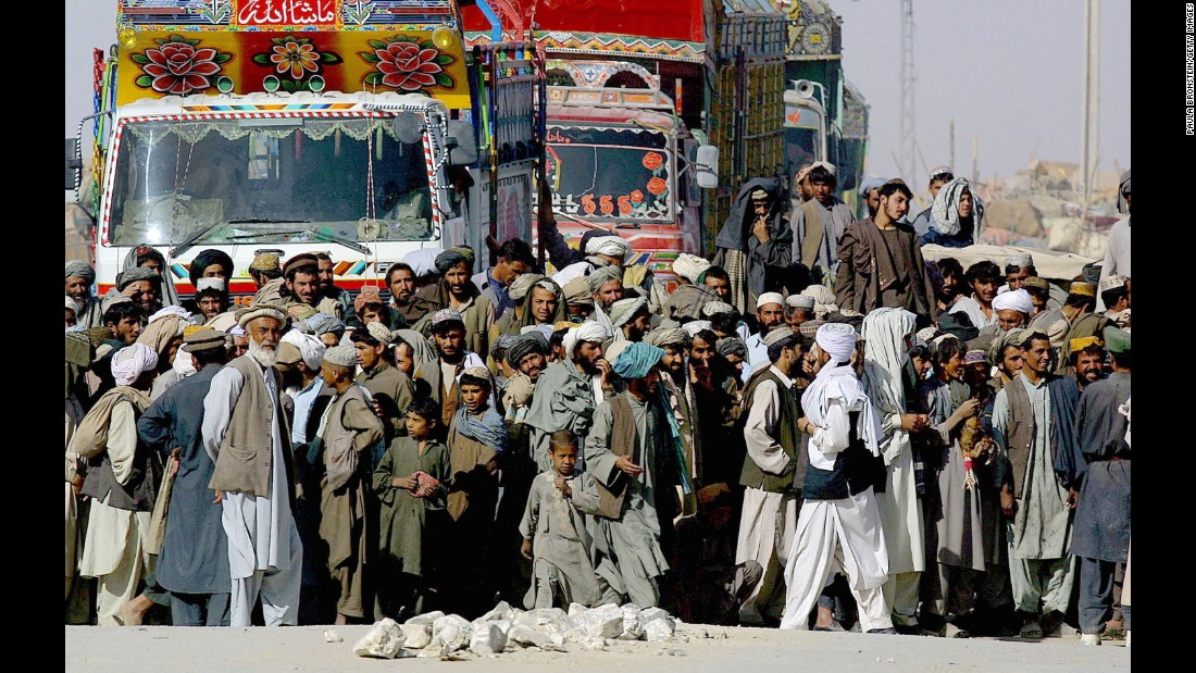 Refugees wait to cross over from Afghanistan at the Pakistan border in 2001. Millions of Afghan refugees remain in Pakistan and Iran; several thousand have been issued visas to the United States.