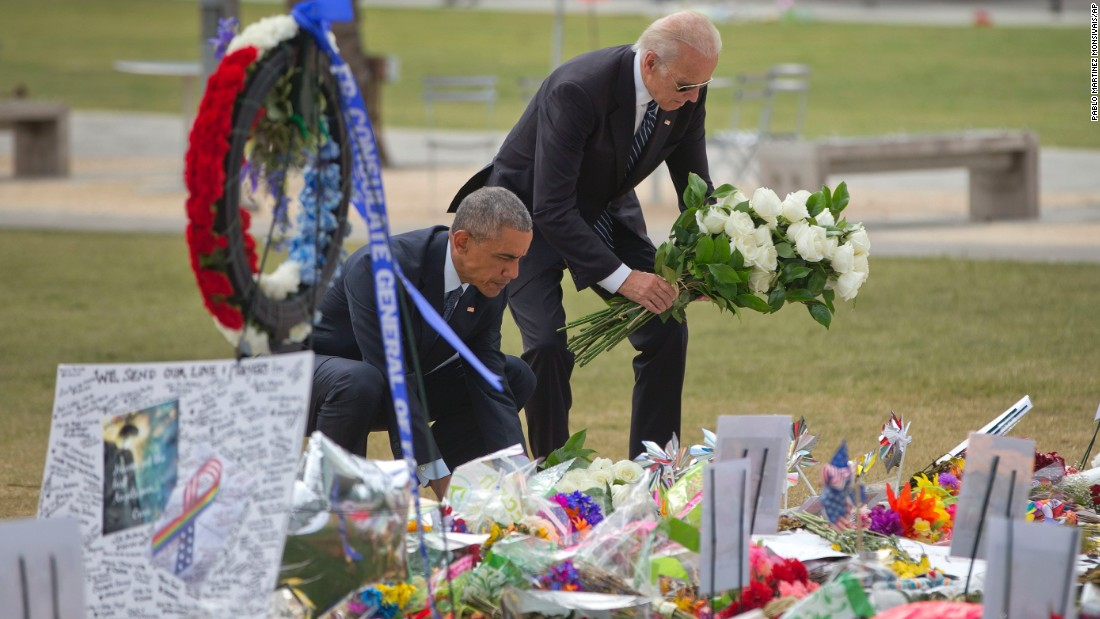 "U.S. President Barack Obama and Vice President Joe Biden place flowers at a memorial Thursday, June 16, for the victims of the nightclub shooting in Orlando. At least 49 people <a href=""http://www.cnn.com/2016/06/12/us/gallery/orlando-shooting/index.html"" target=""_blank"">were killed in the massacre,</a> the deadliest mass shooting in U.S. history."