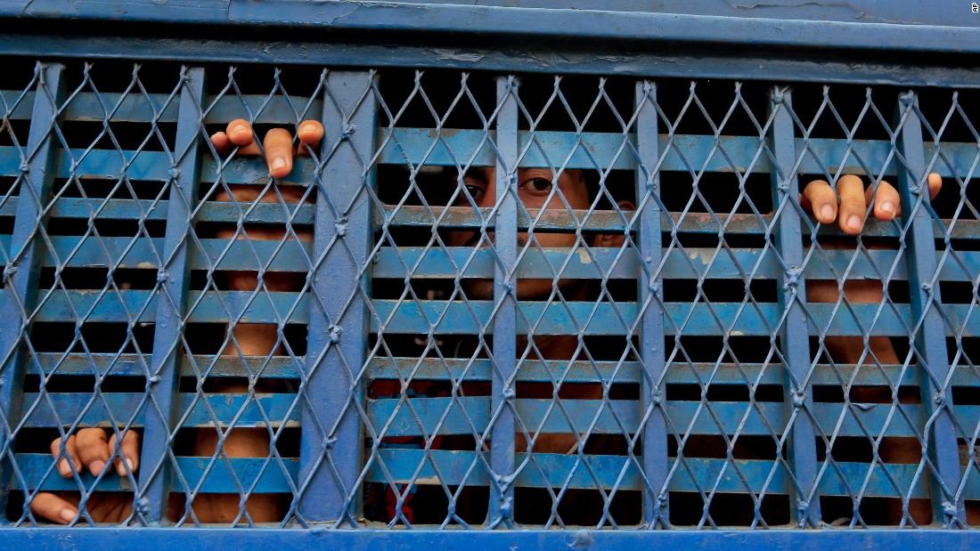 "Men look out from a prison van in Dhaka, Bangladesh, on Monday, June 13. Authorities in Bangladesh have arrested nearly 150 suspected militants and more than 11,000 others <a href=""http://www.cnn.com/2016/06/15/asia/bangladesh-nationwide-raids/"" target=""_blank"">as part of a crackdown on extremism.</a> Police said they detained 145 suspected Islamist militants over four days of raids and that the rest were accused of everything from theft and drug dealing to violence."
