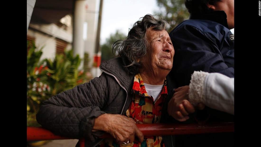 "Victoria Rodriguez cries outside the Tacumbu Prison in Asuncion, Paraguay, after a fire broke out there on Friday, June 10. Her son was in the prison, <a href=""http://www.newindianexpress.com/world/Six-people-die-as-fire-erupts-in-Paraguays-largest-prison/2016/06/11/article3477266.ece"" target=""_blank"">where five inmates and a prison guard died,</a> officials said."