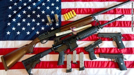 "This February 4, 2013 photo illustration in Manassas, Virginia, shows a Remington 20-gauge semi-automatic shotgun, a Colt AR-15 semi-automatic rifle, a Colt .45 semi-auto handgun, a Walther PK380 semi-auto handgun and various ammunition clips with a copy of the US Constitution on top of the American flag. US President Barack Obama Monday heaped pressure on Congress for action ""soon"" on curbing gun violence. Obama made a pragmatic case for legislation on the contentious issue, arguing that just because political leaders could not save every life, they should at least try to save some victims of rampant gun crime."