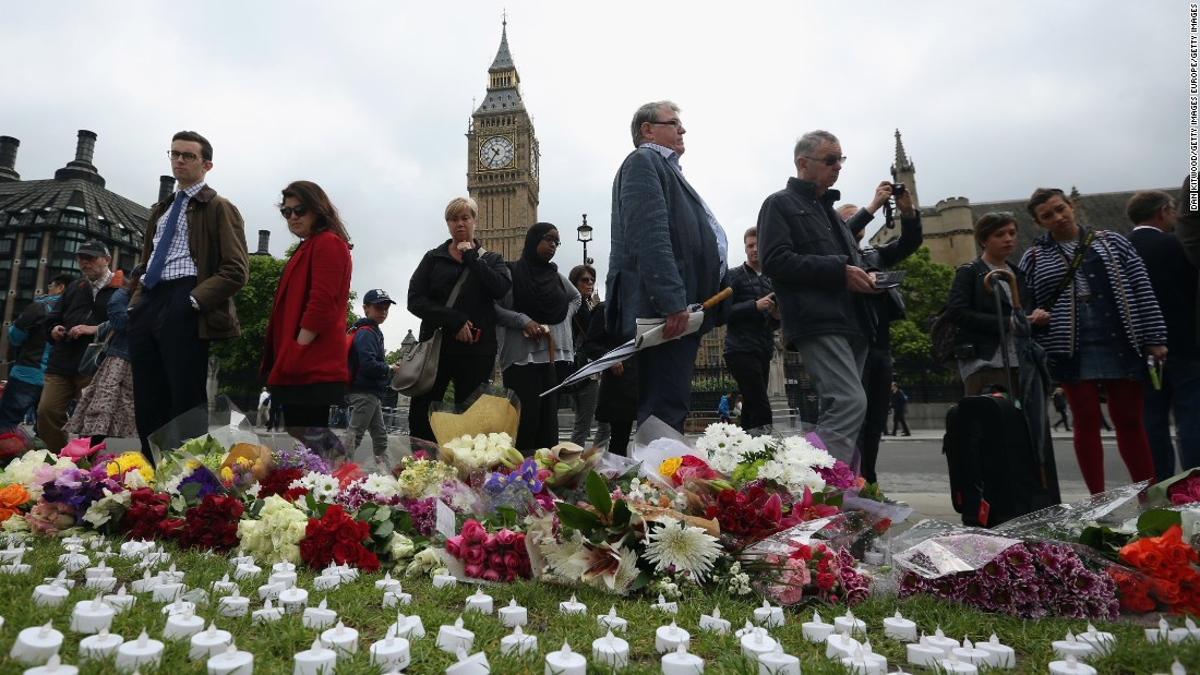 People view tributes at Parliament Square in London on June 17.