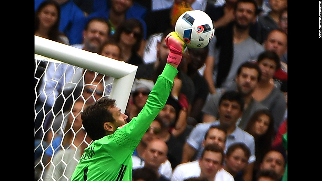 Swedish goalkeeper Andreas Isaksson punches a ball away during the match.