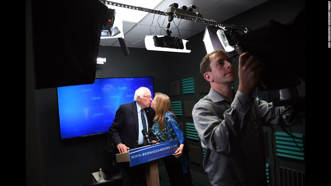 U.S. Sen. Bernie Sanders kisses his wife, Jane, as he prepares to make a video for his supporters Thursday, June 16, in Burlington, Vermont. Sanders is still running for President although Hillary Clinton is the Democratic Party's presumptive nominee.